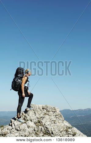 Girl overview landscapes in mountain