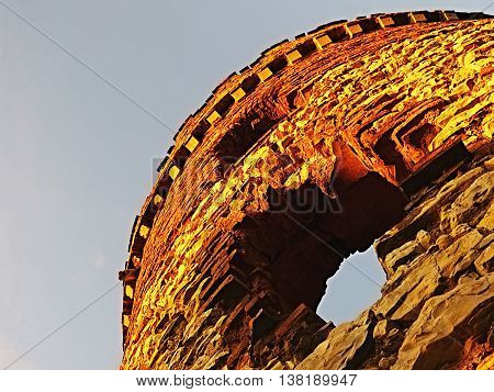 tower ruins of the mill Windsor with two windows appearing like eyes at sunset in Ceske stredohori region near the village Sirejovice in czech republic