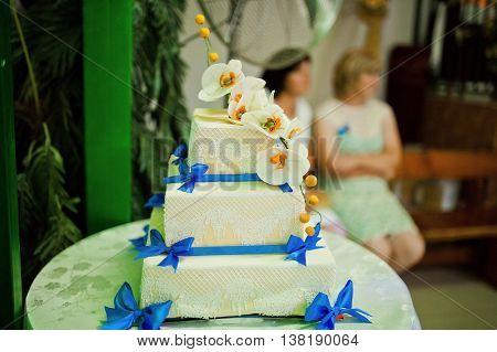 wedding cake with blue ribbon at wedding