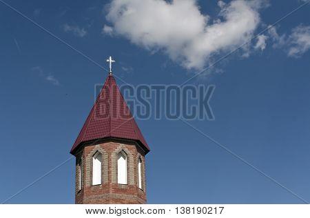 Catholic Church Tower Against Blue Sky.