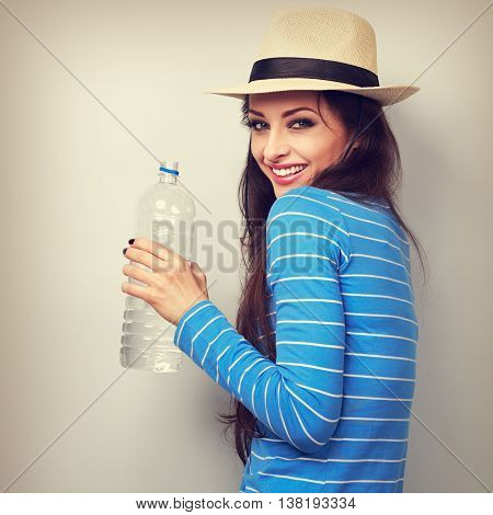 Fun Happy Woman In Summer Hat Drinking Pure Water From Bottle. Toned Closeup Portrait