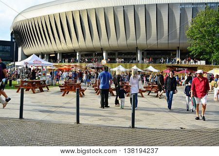 CLUJ-NAPOCA ROMANIA - JULY 10 2016: People flock to the Street Food Festival held in front of the Cluj Arena stadium in central park Cluj. Vendors in stalls sell fast food from different cultures.