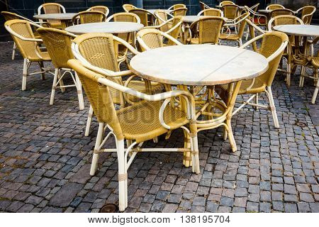 Street view of a coffee terrace with tables and chairs in europe