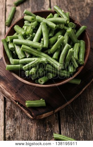 Bunch Of Freshly Picked Green Beans On A Wooden Surface.