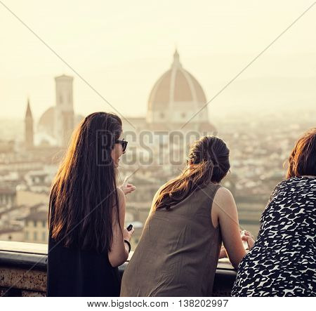 People at sunset watching the view of Florence in a summer day from Piazzale Michelangelo.