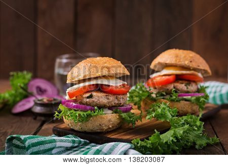 Hamburger (sandwich) With Chicken Burger, Lettuce, Tomato, Fried Egg And Tartar Sauce