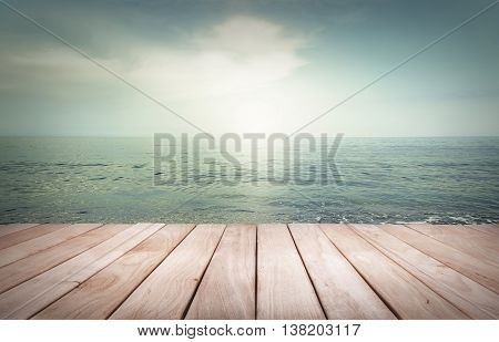 Empty wooden platform and each lapped by the waves in vintage style.