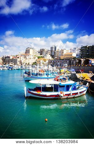 Heraklion old town port with colorful boats, at sunny day, Crete Greece, toned
