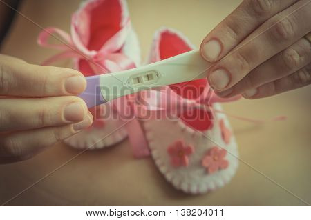 Pregnant Woman Holding A Pregnancy Test