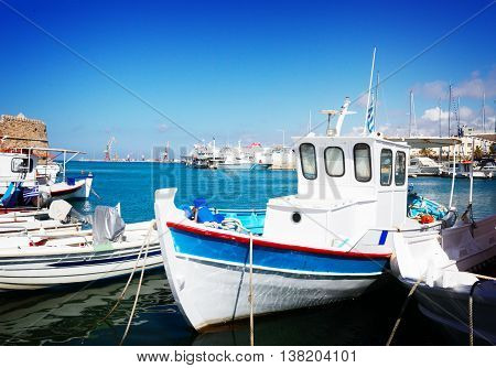 colorful fishing boats in old port of Heraklion, Crete Greece, toned