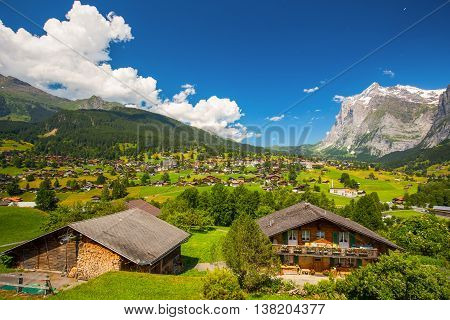 Grindelwald, Switzerland - July 10, 2016 -view To Famous Grindelwald Valley, Green Forest, Alps Chal