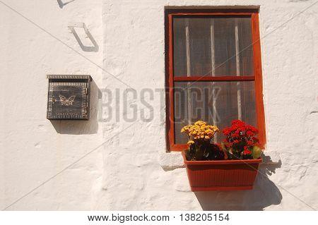 Floral ornament for a window of a trullo in Alberobello - Apulia - Italy