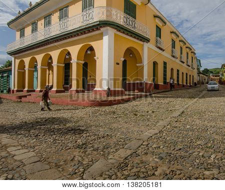 TRINIDAD - CUBA JUNE 15, 2016: A man walks by Museo Romántico (Museum of Romance) that houses an important collection of 19th century furniture and decorative arts.