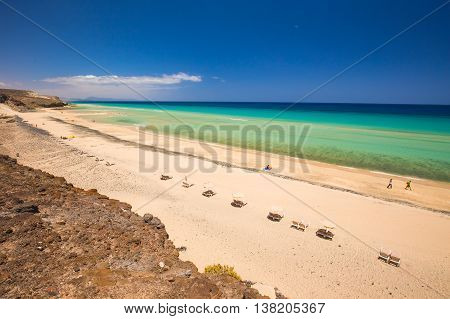 View to sandy beach with vulcanic mountains in the background near to the Costa Calma Fuerteventura Canary Islands Spain.