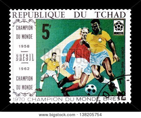 CHAD - CIRCA 1970 : Cancelled postage stamp printed by Chad, that shows football players and Brazilian flag.