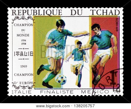 CHAD - CIRCA 1970 : Cancelled postage stamp printed by Chad, that shows football players and Italian flag.