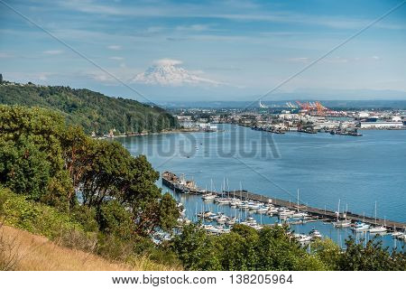 Clouds hover near Mount Rainier with the Port of Tacoma below.