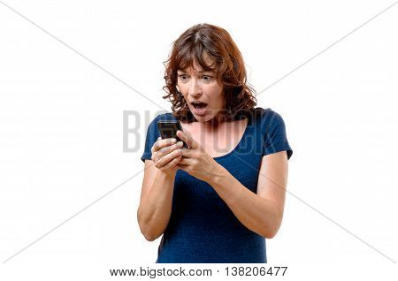 Horrified Middle-aged Woman Looking At Her Mobile