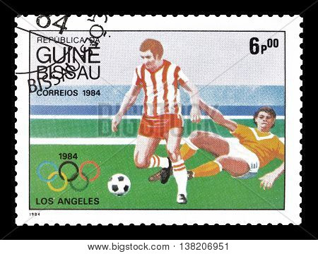GUINEA BISSAU - CIRCA 1984 : Cancelled postage stamp printed by Guinea Bissau, that shows football players.