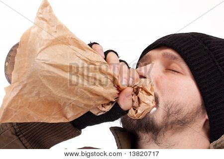 Young Homeless Man Drinking