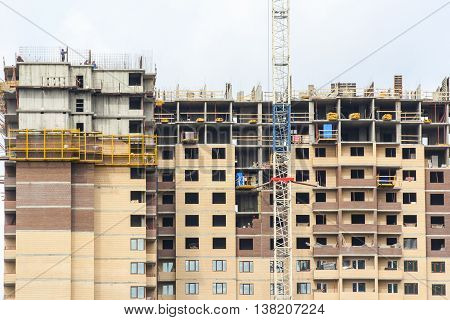 Construction of multi-storey buildings. Urban workers profession and people at work.
