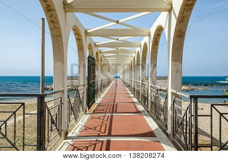 Pier for pedestrians as seen from Via Duca Daosta in Civitavecchia Port of Rome as example of geometrical pattern in building gesign.
