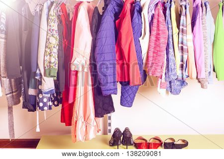 Choice Of Fashion Clothes Of Different Colors In Walk-in Clothing Closet Or Store. Colorful Choices