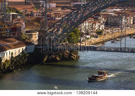 PORTO, PORTUGAL - JUL 12, 2016: Tourist boats on the Douro river at Ribeira, historical center of Porto. City of Porto won the European Best Destination 2012 and 2014 awards.