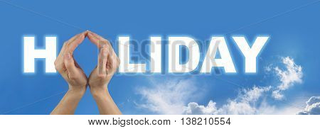 Time to Plan Your Holiday - female hands making the O of the word HOLIDAY on a wide blue sky background with a few stray clouds underneath