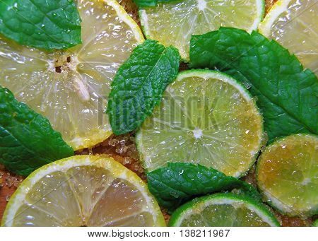 Slices Of Limes And Lemons, Leaves Of Mint And Cane Sugar