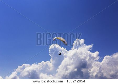 Paraglider Flying Over Clouds