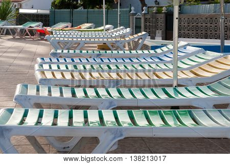 A shot of many sunloungers in a swimming pool terrace