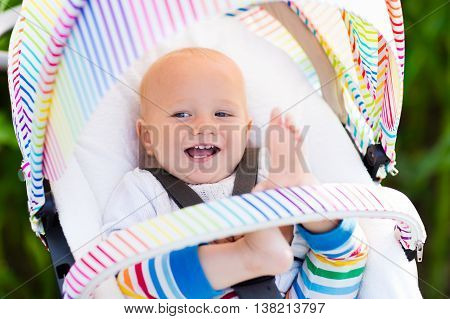 Baby In White Stroller