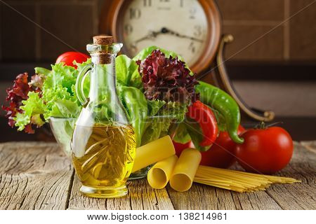 Juicy Tomatoes, Spinach, Lettuce And Many Kinds Of Italian Pasta On The Kitchen Table
