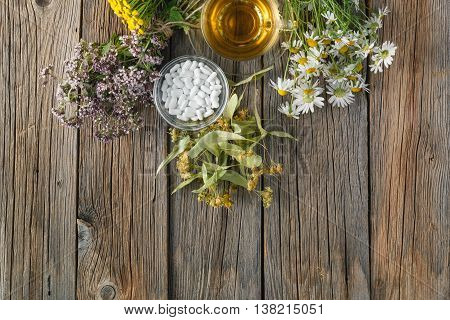 Ancient herbal medicine on rustic wooden background