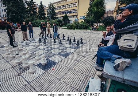 Sarajevo Bosnia and Herzegovina - August 23 2015. Men plays large chess at Liberation Square in Sarajevo city