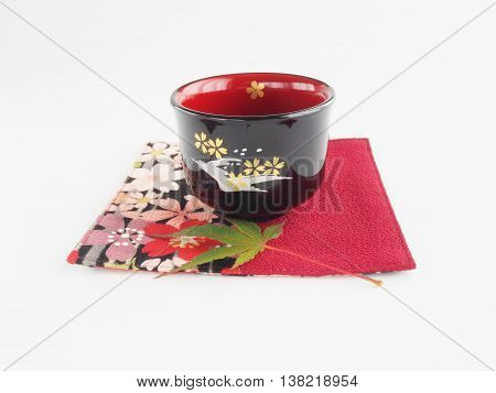 Sake(rice wine) cup, beautiful color of lacquered  on white background