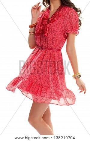 Woman wearing short sleeve dress. Dotted pattern on red dress. Beautiful girl in stylish clothes. Set of quality accessories.