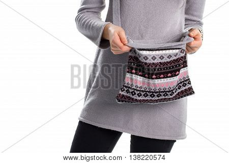 Woman in pullover holds bag. Handbag with dark print. Long warm sweater. Gray woolen garment and purse.