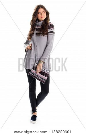 Lady in long gray pullover. Black slip ons and pants. Casual clothing for autumn. Outfit with trendy footwear.