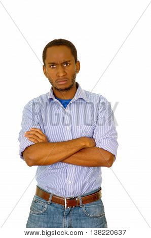 Handsome man wearing jeans and light blue shirt standing in front of camera with serious facial expression, white studio background.