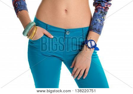 Blue watch on woman's hand. Pants and bracelets. Stretch trousers and plastic bracelets. Colors of spring.