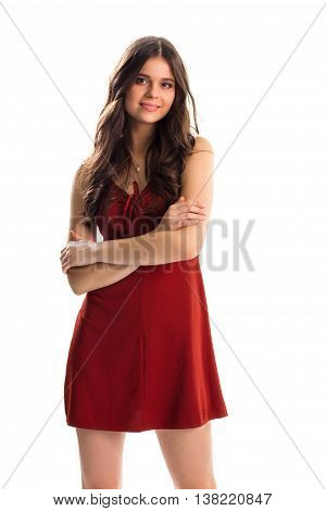 Lady in red keyhole dress. Woman with crossed arms smiling. Model wears new evening dress. Kindness and charm.