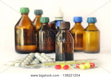 Medical bottles for mixtures, syrups and healthcare oils on white background