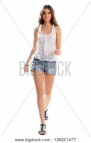 Girl in blouse is walking. Short shorts and sandals. Simple design of summer clothing. Lightness, beauty and comfort.