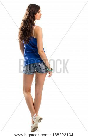 Woman in blue tank top. Back view of short shorts. Casual outfit with sandals. Youth and lightness.