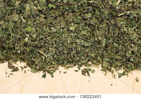 Dried Nettle Leaves On Wooden Board With Copy Space