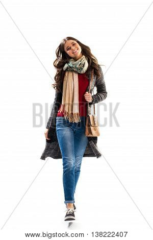 Lady is walking and smiling. Black and gray sweater coat. Model in spring outerwear. Trendy and comfortable clothes.