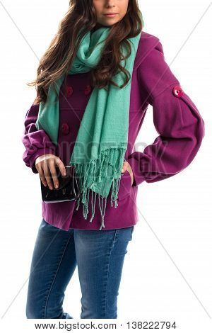 Woman in purple coat. Turquoise scarf and black wallet. Trendy outerwear and new accessory. Advertisement of clothes shop.