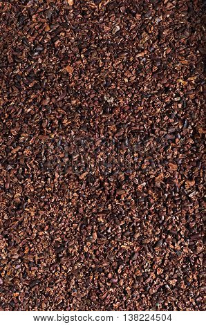Crushed cocoa beans. The image can be used as a background.